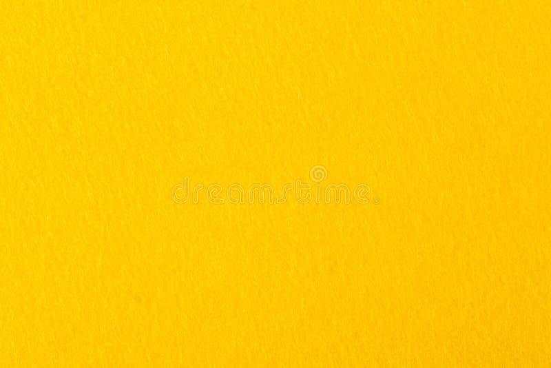与优质黄色毛毡的抽象背景 免版税库存照片