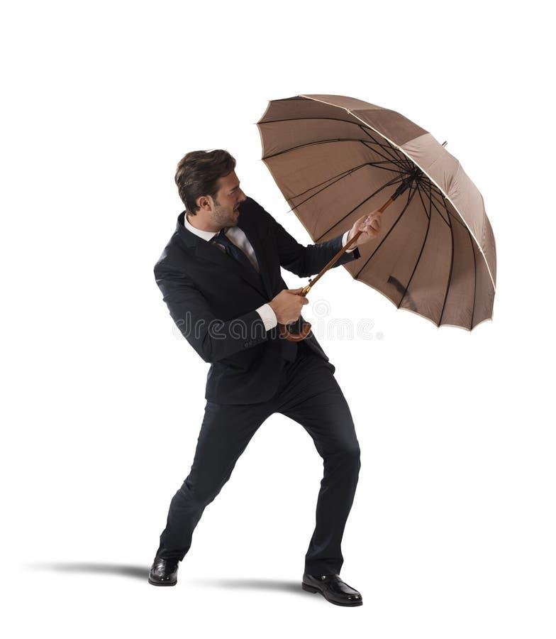 与伞的生意人 库存照片