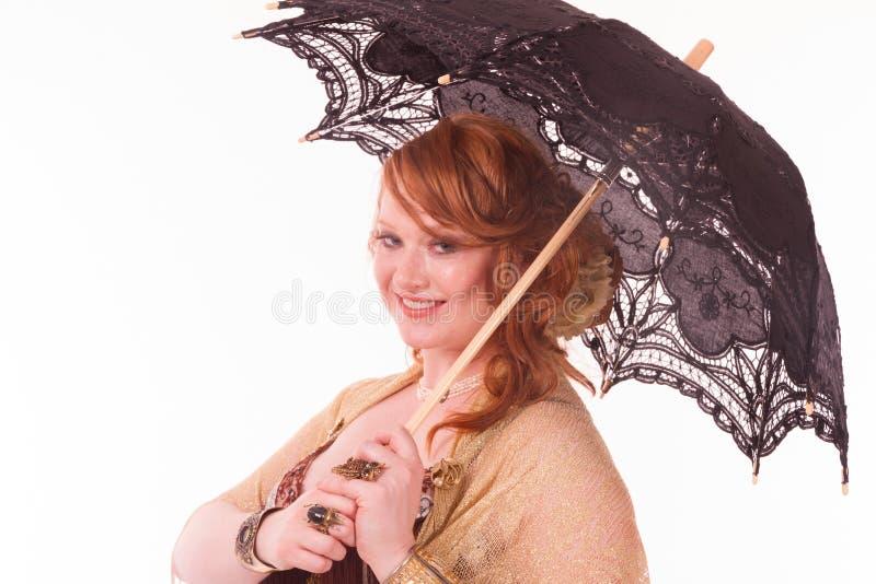 与伞纵向的Bellyancer 免版税库存图片