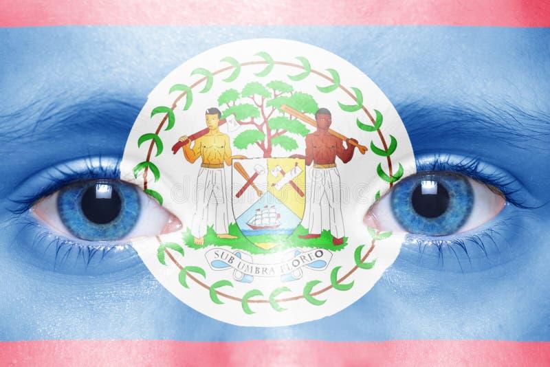 与伯利兹旗子的人的` s面孔 免版税库存照片