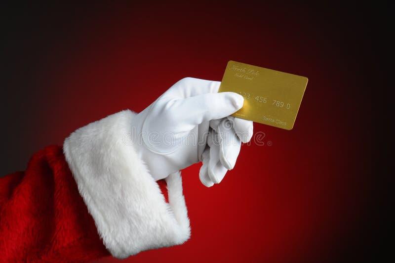 与信用卡的金子的圣诞老人 免版税库存照片