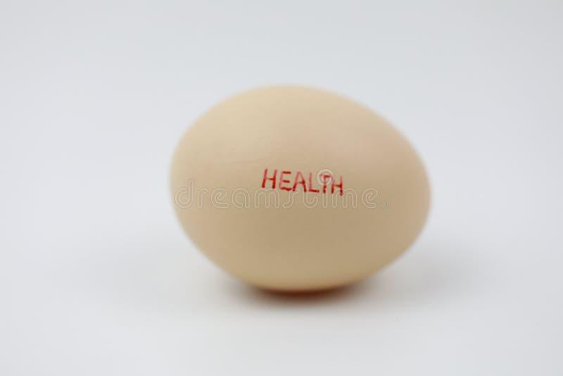 与健康字符的新鲜的鸡蛋 库存图片