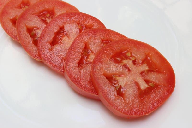 与关闭的发光的蕃茄切片 库存图片