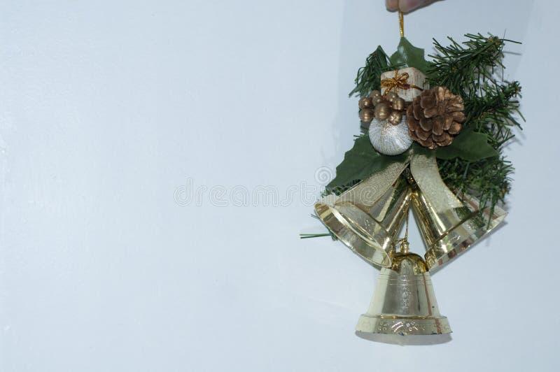 与写圣诞节消息的空间的响铃 库存图片