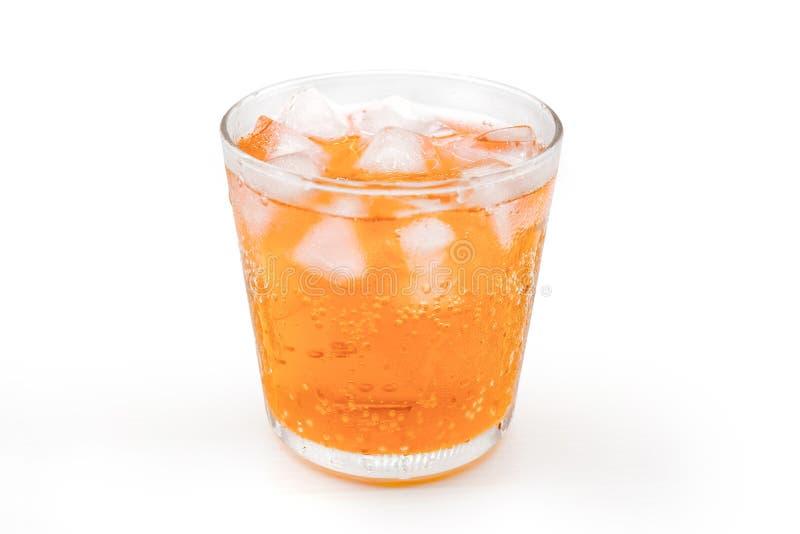 与冰的桔子在玻璃 免版税库存照片