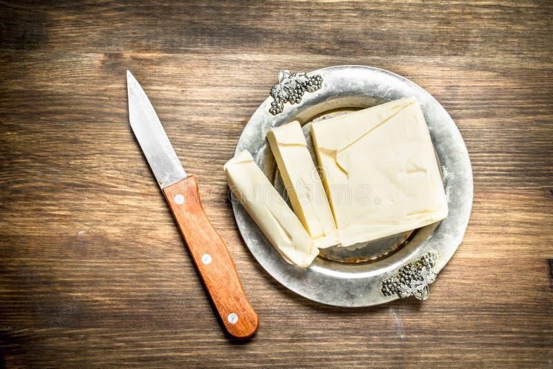 与刀子的黄油 免版税库存照片