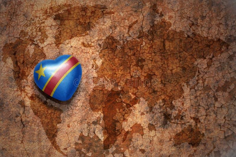 与刚果民主共和国的国旗的心脏葡萄酒世界地图裂缝纸背景的 免版税库存图片