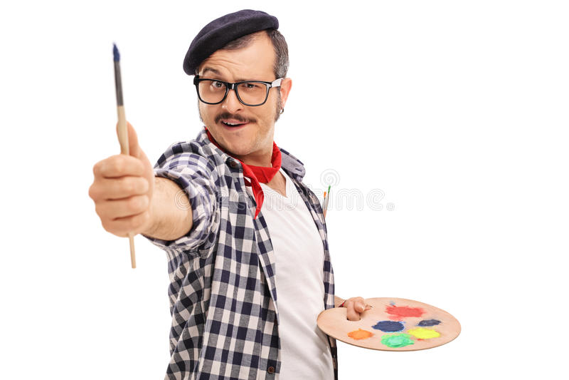与刷子的艺术家测量的比例 图库摄影