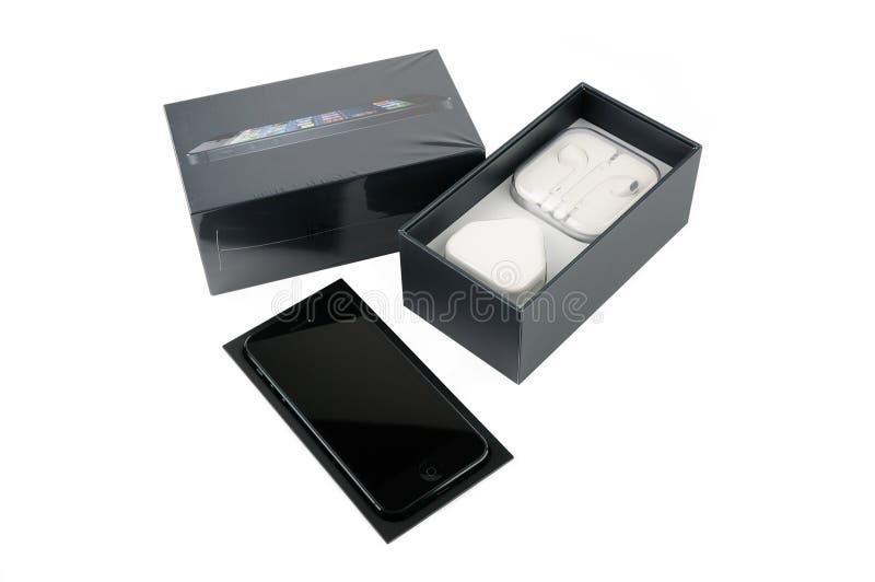 与包装的IPhone 5 免版税库存图片