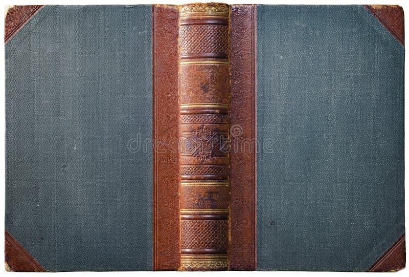 与压印的棕色皮革脊椎的老开放书套 免版税库存照片