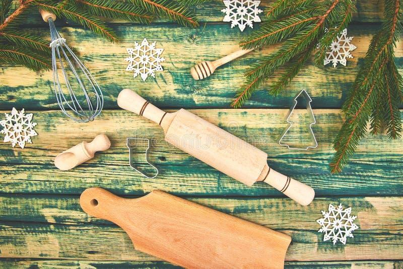 与厨房用具的圣诞节烹调或烘烤的食物背景 库存图片