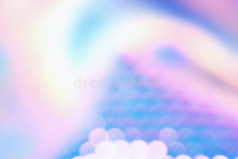 与发光的反射和bokeh光线影响的全息照相的颜色箔 库存照片