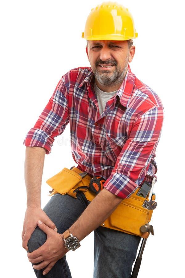 与受伤的膝盖的建造者 免版税库存图片