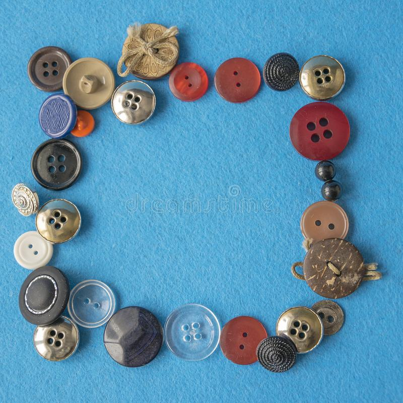 与各种各样的缝合的按钮的好的五颜六色的框架 免版税库存图片