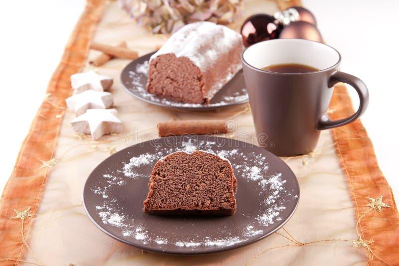 与咖啡的圣诞节蛋糕 免版税库存照片