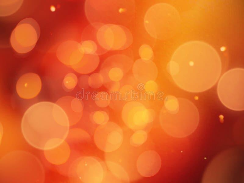 与圆的光和闪闪发光背景的发光的明亮的橙色被弄脏的摘要 库存图片