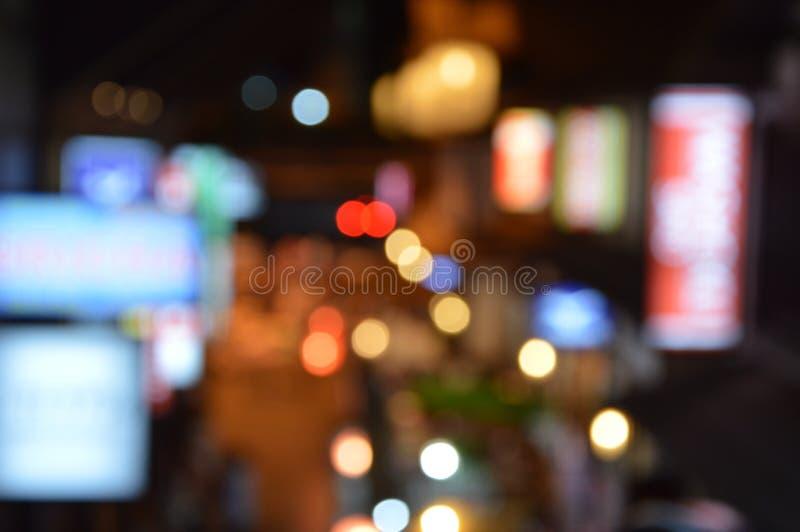 与圈子光的被弄脏的夜城市背景 迷离背景概念 免版税图库摄影