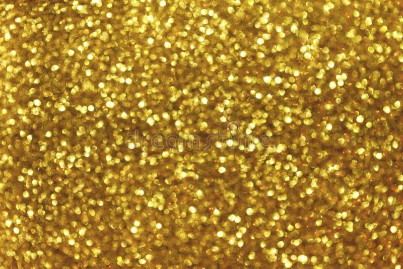 与圈子闪耀的光的被弄脏的金黄背景 圣诞节诗歌选发光的黄色闪光bokeh  黑暗的背景 库存图片