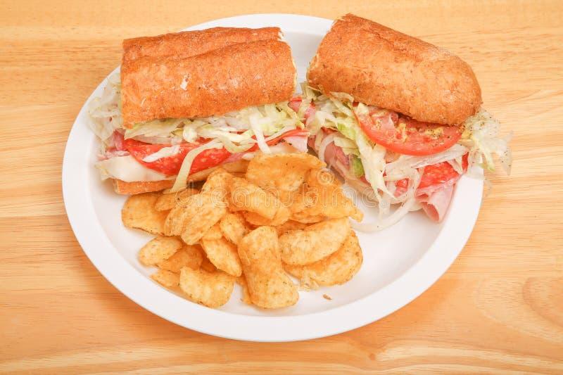 与土豆片的意大利次级三明治 库存照片