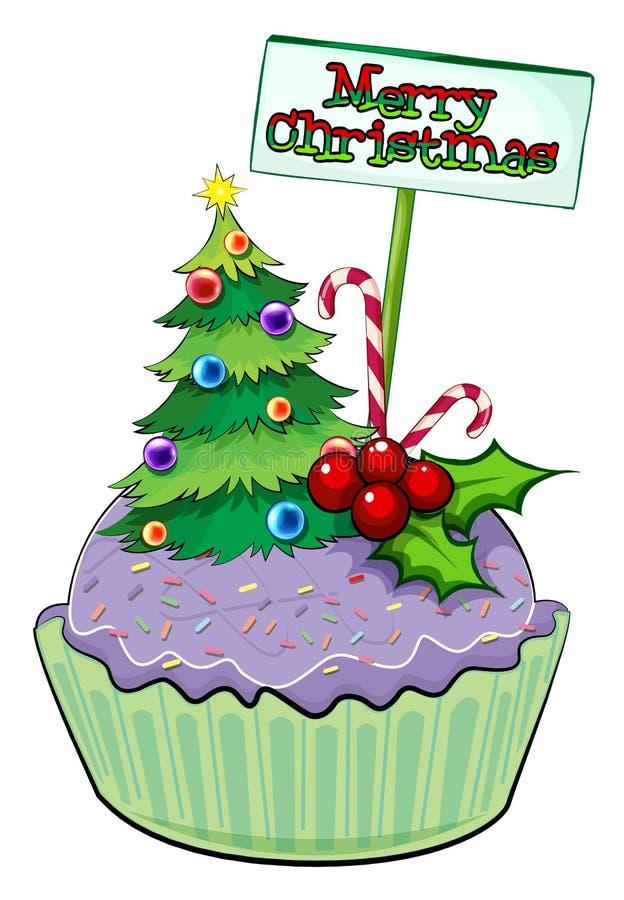 与圣诞树和卡片的一块杯形蛋糕 库存例证