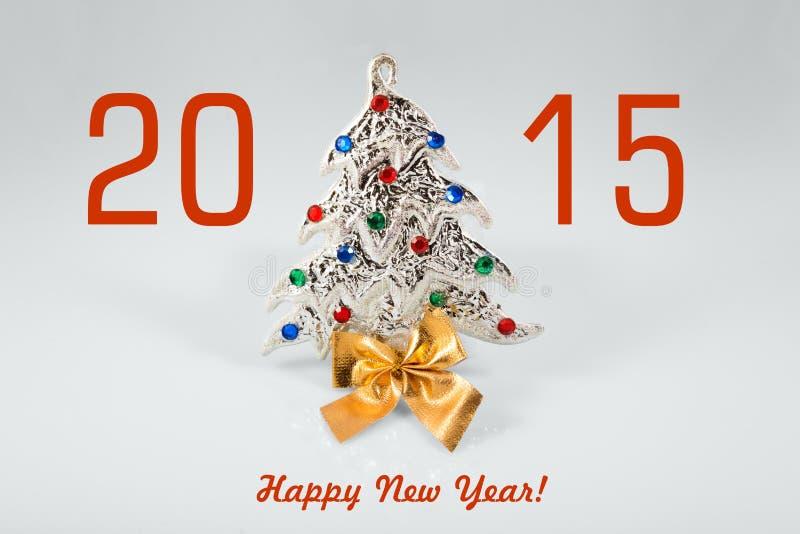 与圣诞树玩具的新年2015标志在白色背景 看板卡新年好 库存图片
