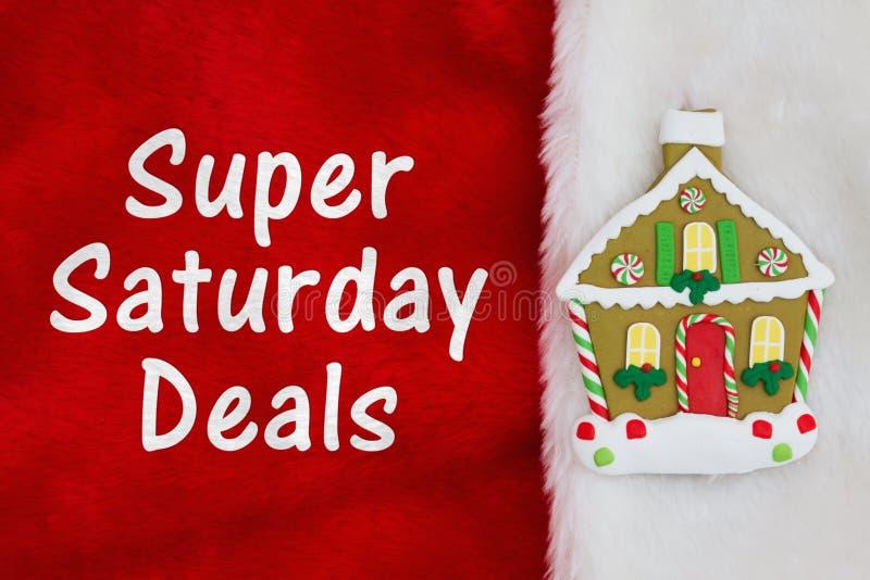 与圣诞节华而不实的屋的超级星期六成交红色和白色豪华的织地不很细织品的 免版税库存照片