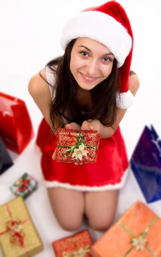 与圣诞节礼品的新女性圣诞老人 图库摄影