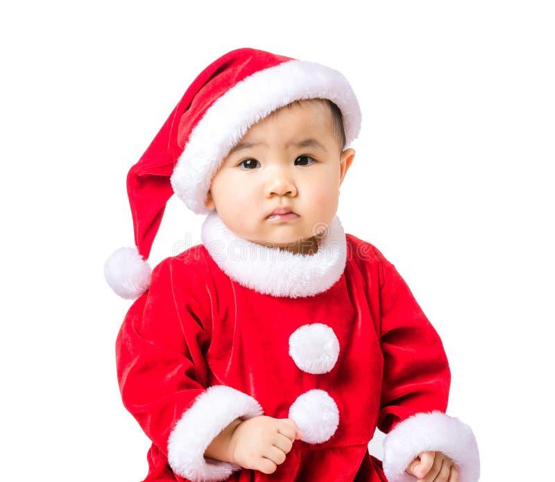 与圣诞节选矿的小女孩画象 免版税库存照片