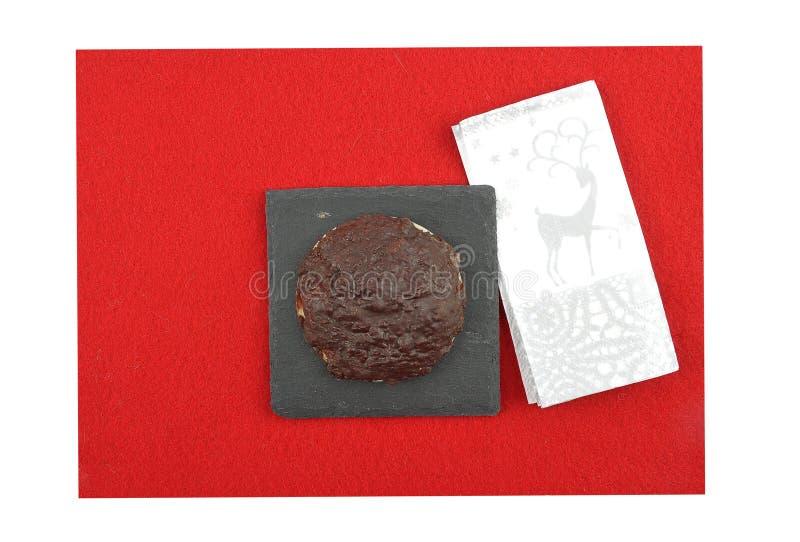 与圣诞节餐巾的德语Lebkuchen在毛毡 免版税库存图片