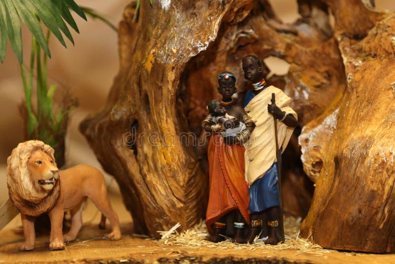 与圣洁家庭的诞生场面与狮子 免版税库存图片