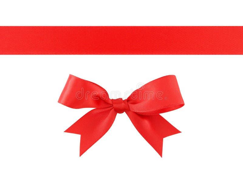 与在白色背景隔绝的弓的红色丝带,朴素装饰为增加秀丽到礼物盒和贺卡 库存照片