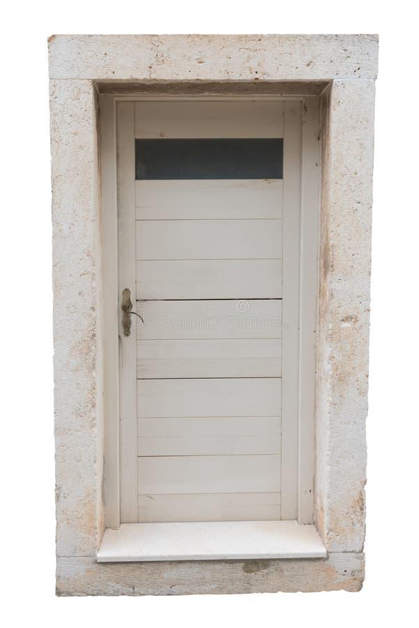 与在白色背景隔绝的石框架的白色门 外部细节 被保存的道路 免版税库存照片