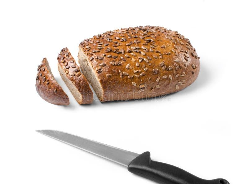与在白色背景隔绝的刀子的面包 库存照片