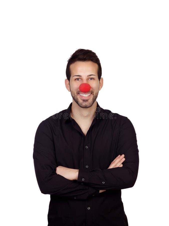 与小丑鼻子的年轻商人 库存照片