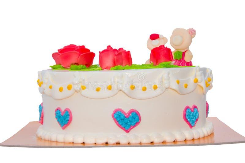 与在白色背景隔绝的玫瑰的奶油色蛋糕 免版税库存图片