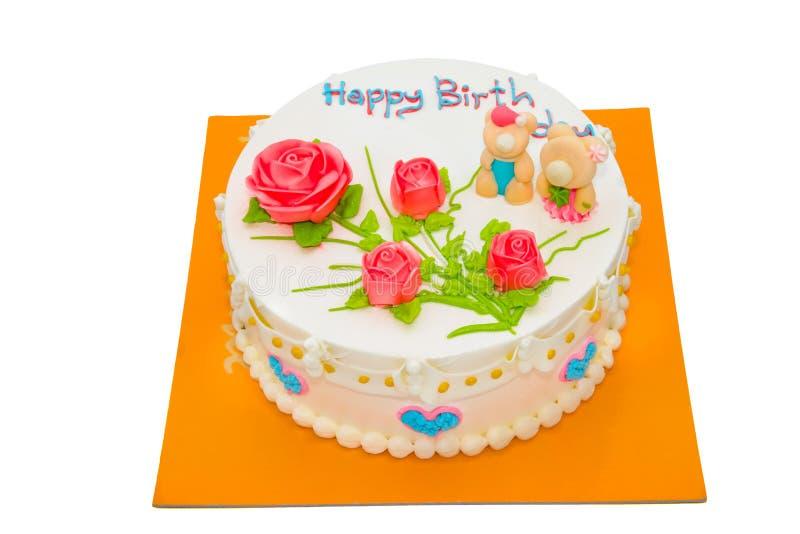 与在白色背景隔绝的玫瑰的奶油色蛋糕 免版税库存照片