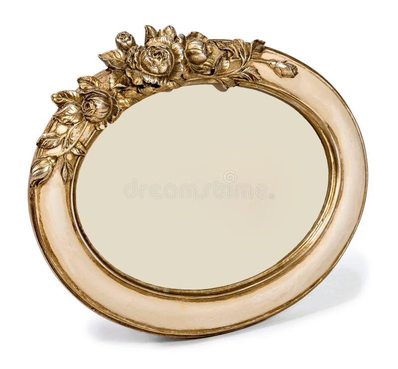 与在白色背景隔绝的花卉装饰的被镀金的装饰fhoto框架 免版税库存图片