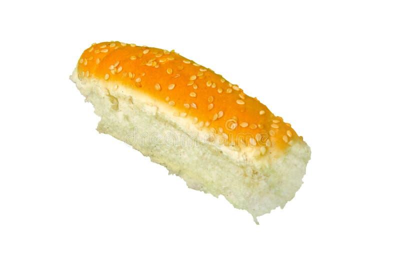 与在白色隔绝的芝麻籽的面包 库存照片