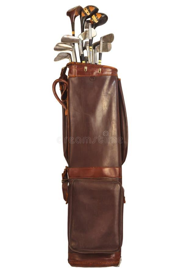与在白色隔绝的高尔夫俱乐部的古色古香的袋子 免版税库存图片