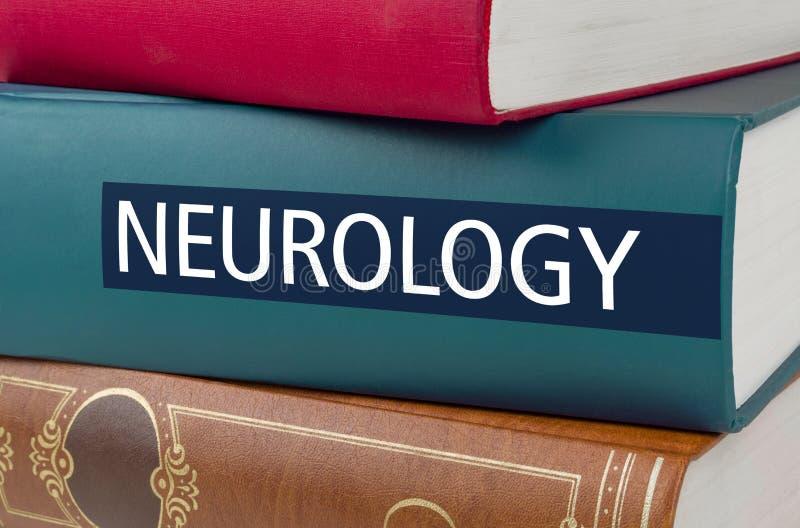 与在脊椎写的标题神经学的一本书 免版税库存照片