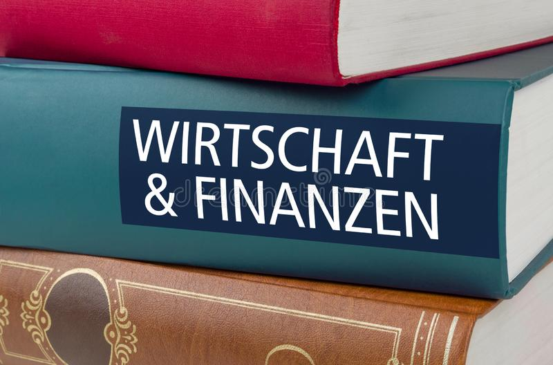 与在脊椎和财务写的标题事务- Wirtschaft und德语的Finanzen的一本书 免版税图库摄影