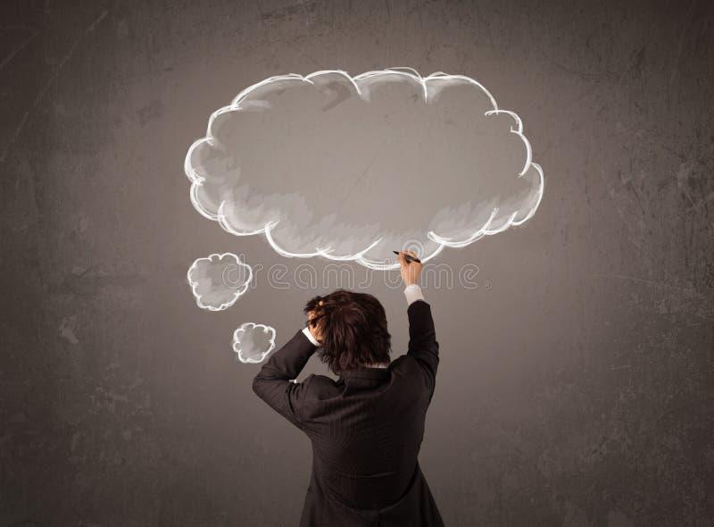 与在他的头上被认为的云彩的商人 免版税库存照片