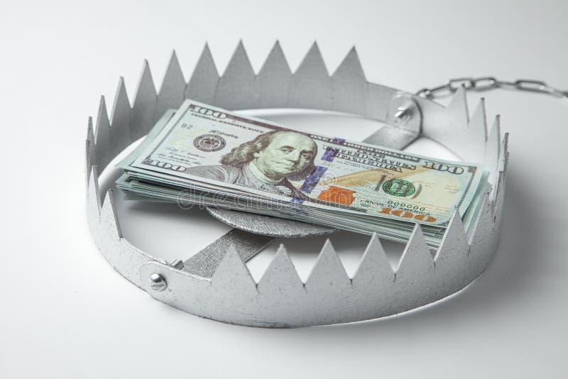 与堆的陷井金钱 投资的危险在事务的风险或欺骗 E 库存照片