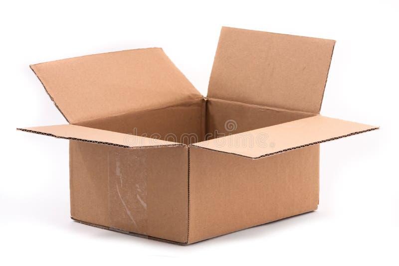 与塑料磁带的开放纸板箱 免版税库存图片