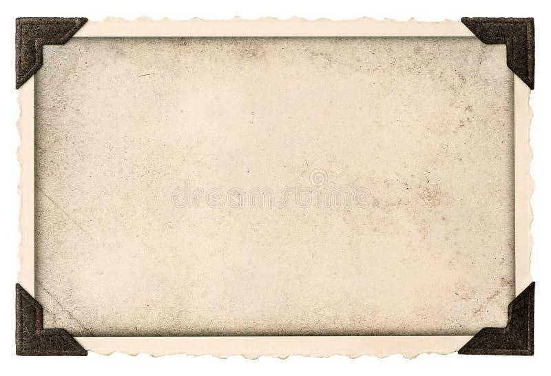 与壁角和空的领域的老照片框架您的图片的 免版税库存照片