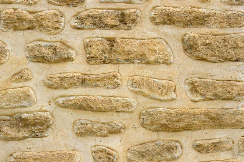 与大型石头的石老墙壁背景 免版税库存图片