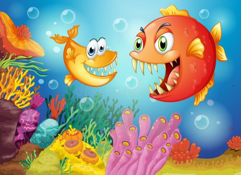 与大犬齿的两条鱼在海下 皇族释放例证