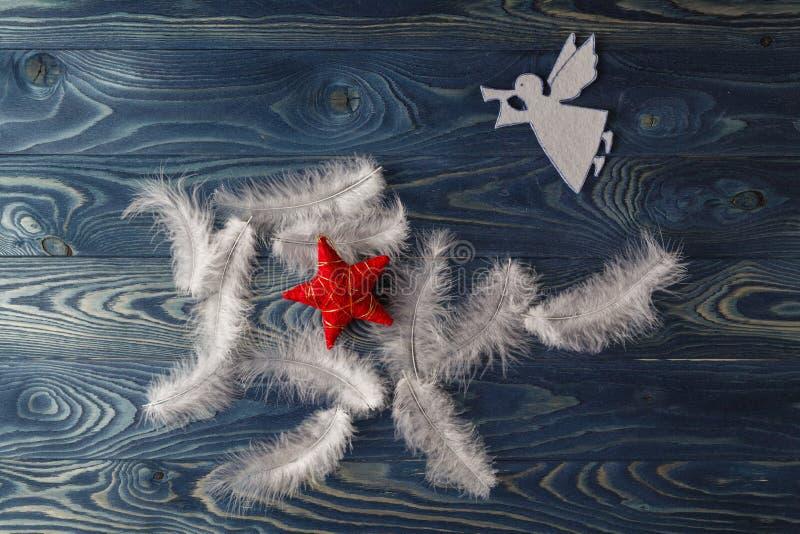 与天使的圣诞快乐卡片 库存照片