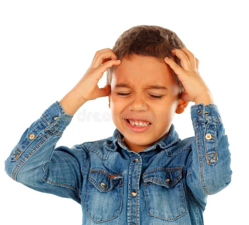 与头疼的拉丁孩子 库存照片