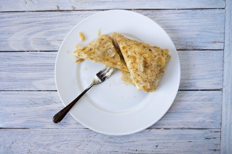 与奶油的甜吹蛋糕 免版税库存照片